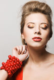 Gorgeous young woman with a red bracelet Royalty Free Stock Photo