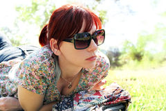 Gorgeous young woman relaxing in the park Stock Photos