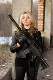 Gorgeous young woman with a rifle Royalty Free Stock Images