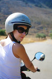 Gorgeous young woman on the scooter wearing helmet Stock Photography