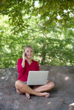 Gorgeous young woman searching for inspiration in working in park Royalty Free Stock Images