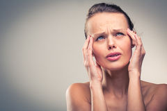 Gorgeous young woman with severe headache/migraine Royalty Free Stock Photos