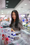 Gorgeous young woman shopping Stock Photos