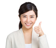 Gorgeous young woman showing thumb up. Isolated on white Royalty Free Stock Image