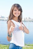 Gorgeous young woman showing thumbs up Royalty Free Stock Photo
