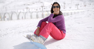 Gorgeous young woman using a snowboard Royalty Free Stock Images
