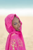 Gorgeous young woman wearing a pink veil at the beach stock photo