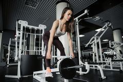 Gorgeous young woman working out with hand weights to keep her slim figure shapely stock photos