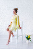 Gorgeous young woman in yellow dress Royalty Free Stock Images