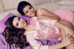 Gorgeous young women with dark hair in elegant home clothes Royalty Free Stock Photography