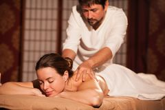 Young woman enjoying professional massage stock photo