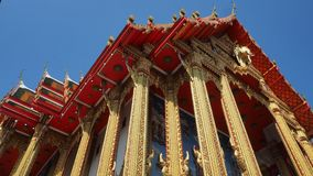 Gorgeously crafted Thai temple with golden columns Royalty Free Stock Photo
