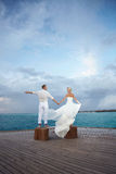 Gorgerous just married couple standing on pier after wedding. Stock Photo
