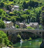 Gorges du Tarn. (Lozere, Linguedoc-Roussillon, France), famous canyon at summer. Village, bridge and canoes Royalty Free Stock Photography