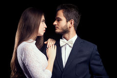 Gorgoeus woman in body lingerie next to man in suit Stock Image