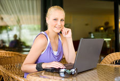 Gorgoeus young blonde having fun with laptop. Royalty Free Stock Image