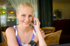 Gorgoeus young blonde talking on her cellphone. Royalty Free Stock Photos