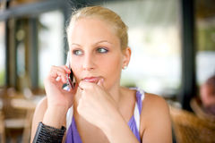 Gorgoeus young blonde talking on her mobile phone. Stock Image