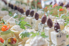 Gorgonzola and black olive party canape Stock Photos