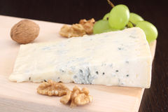 Gorgonzola blue cheese with grapes and walnuts Royalty Free Stock Photography