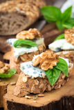 Gorgonzola canape. Roquefort and walnut canape decorated with leaves of fresh basil Stock Photography