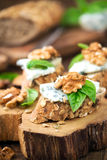 Gorgonzola canape. Roquefort and walnut canape decorated with leaves of fresh basil Stock Photo