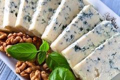 Gorgonzola cheese with basil and walnuts Royalty Free Stock Image