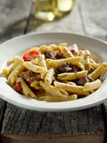 Gorgonzola cheese in pasta with beef and red bell Royalty Free Stock Photo
