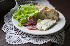 Gorgonzola cheese, sausage and ciabatta on a white plate Royalty Free Stock Photography