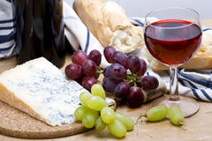 Gorgonzola lunch. A glass of red wine with baguette and grapes in rustic still life Stock Photography