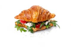 A gorgonzola, rocket, and tomato croissant on the whie background stock photo