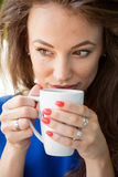 Gorgoues young woman drinking a cup of coffee Royalty Free Stock Photo