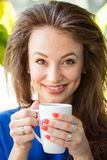 Gorgoues young woman drinking a cup of coffee Royalty Free Stock Image