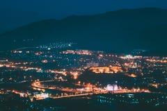 Gori, Shida Kartli Region, Georgia. Gori Fortress In Cityscape In Evening Illumination Under Blue Sky. Travel. Destination In Night Lights. Goris Tsikhe Is A royalty free stock photography