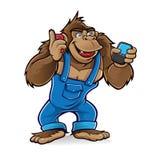 Gorila dos desenhos animados com telefones móveis Foto de Stock Royalty Free