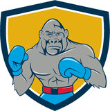 Gorilla Boxer Boxing Stance Crest Cartoon. Illustration of a gorilla boxer in boxing stance viewed from front set inside shield crest done in cartoon style Stock Images