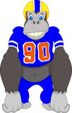 Gorilla cartoon playing american fooball Royalty Free Stock Image