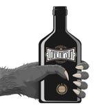 Gorilla Hand avec la bouteille Photographie stock libre de droits