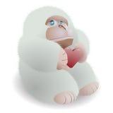 Gorilla holding heart. On a white background Stock Photos