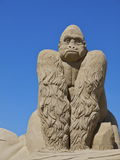 Gorilla sand sculpture. Sand sculpture of a giant gorilla against blue sky background Stock Photos