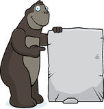 Gorilla Sign. A happy cartoon gorilla with a stone sign Royalty Free Stock Image