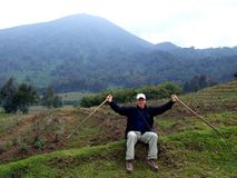 Gorilla Trek. Tourists hiking Gorilla Trek at Volcanoes National Park in Rwanda Royalty Free Stock Image