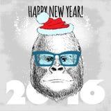 Gorillaaffe Hippie mit blauen Gläsern und Weihnachtshut Lizenzfreie Stockbilder