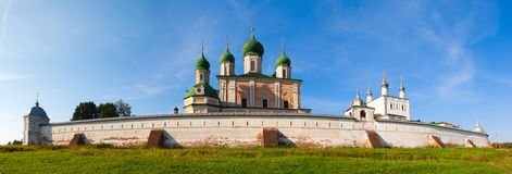 Goritsky monastery. And the white walls with domes on a background of blue sky and with green grass Stock Photography