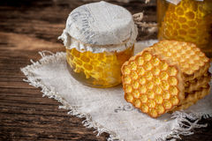 Gorka honey cookies and a glass honeycomb Royalty Free Stock Photo