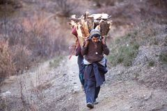 Gorkhas men carry heavy basket in the Himalaya Stock Photos