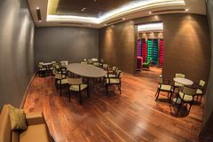 Gorki Art Hotel`s wine tasting room hall in Gorky Gorod resort in Sochi performed in elegant wooden style. Fish eye view stock photo