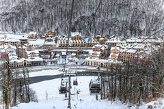Gorky Gorod resort cableway ski lift on snowy trees background beautiful winter scenery Royalty Free Stock Image