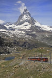 The Gornergrat railway and Matterhorn, Switzerland. The Gornergrat railway is a mountain rack railway, located in the Swiss canton of Valais. It links the resort stock photography