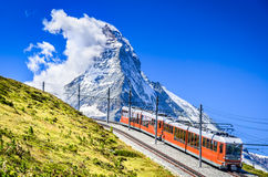 Gornergrat train and Matterhorn. Switzerland. Matterhorn, Switzerland. Gornergratbahn is a 9 km long gauge mountain rack railway leading from Zermatt (1604 m) Stock Images